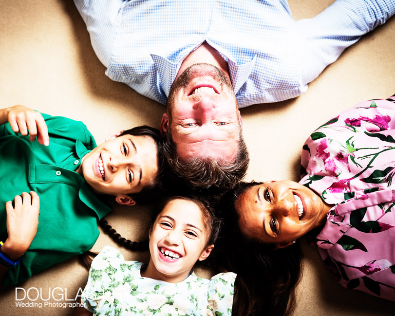 fun family photograph of heads together on the floor at home