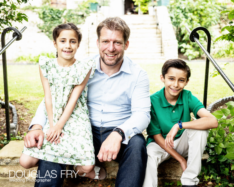 Father with children photographed in garden at home near Oxford - Islip