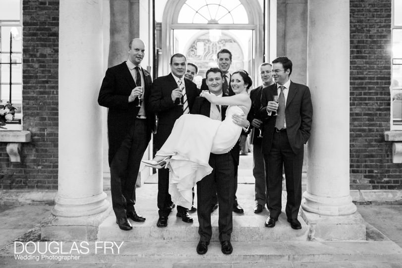 Bride with ushers and groom in front of HAC