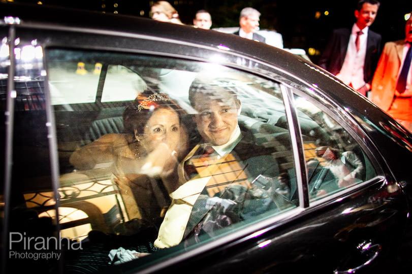 Bride and groom leaving HAC in car