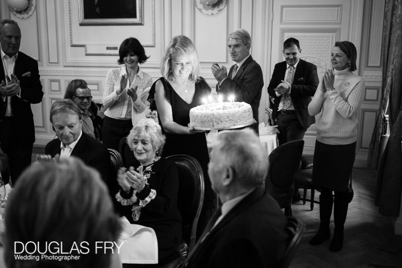 Birthday Party Photographer London - The cake being brought in