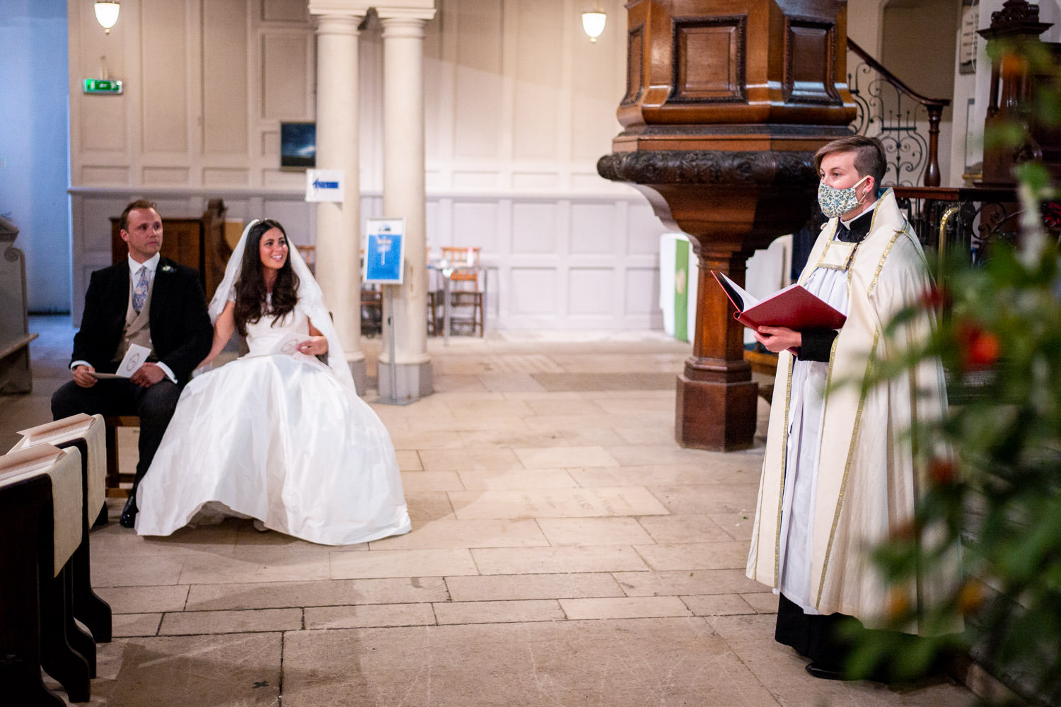 Vicar photographed during wedding ceremony wearing face mask in London church