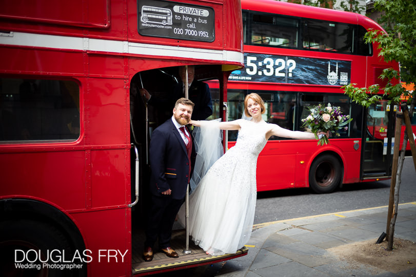 Bride and groom photographed on wedding day with London bus on Kings Road near Chelsea Register office
