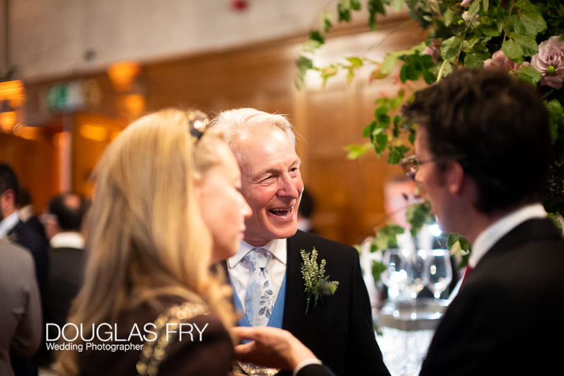 guests at wedding reception photographed with Leica Noctilux Lens in low light
