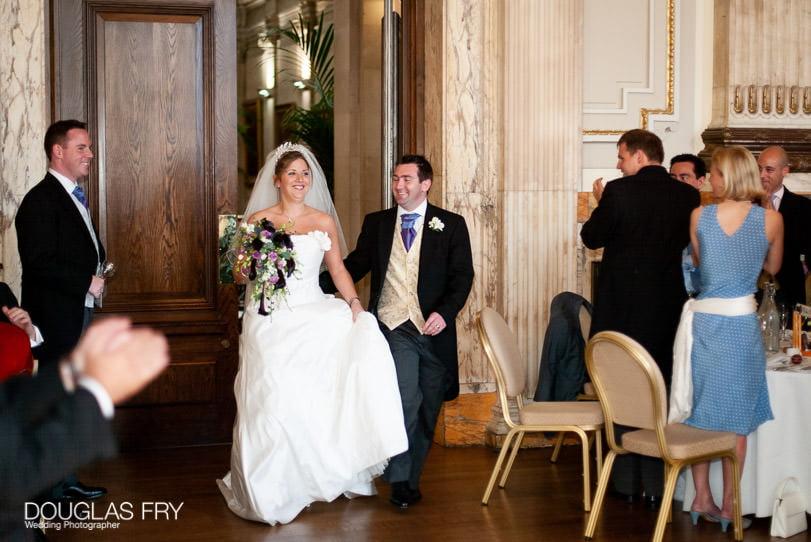 Wedding Photographer One Great George Street London - entering the dinner