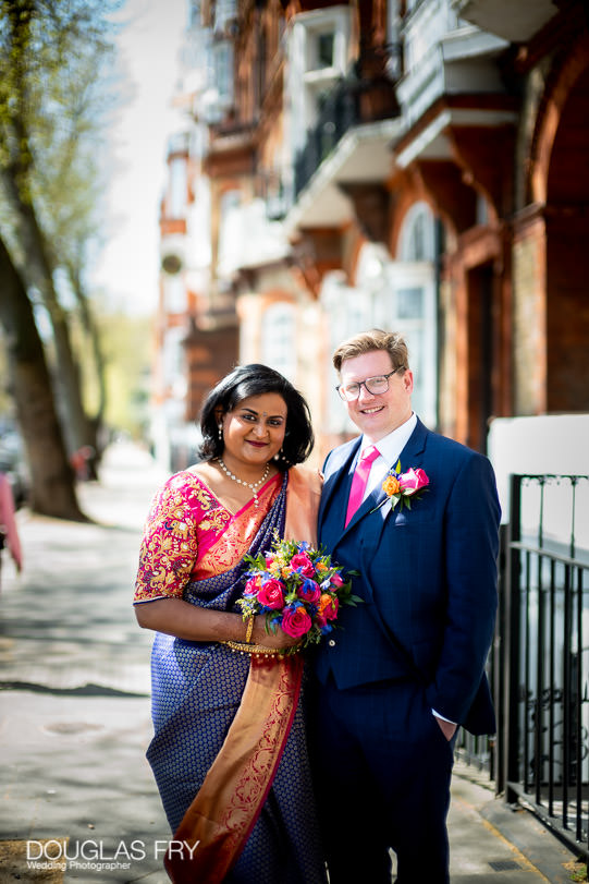 Bride and groom photographed together in London