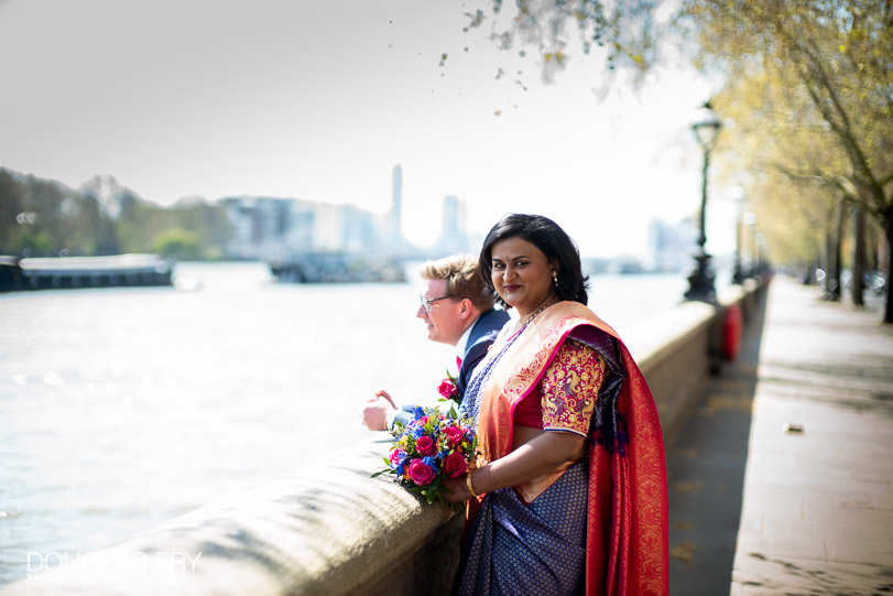 Bride and groom photographed together on the Embankment in London