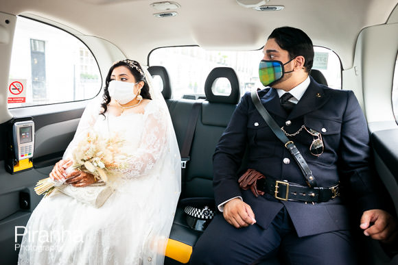 couple photographed together on way to wedding in taxi