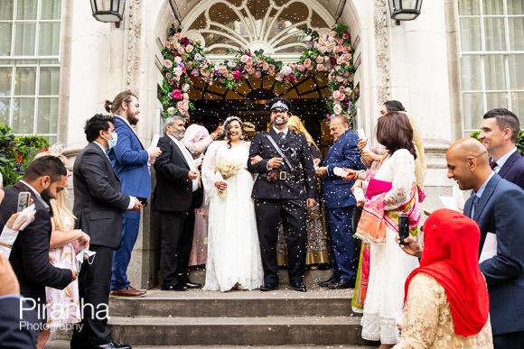 Wedding photographer picture of couple on steps of chelsea town hall kings road London