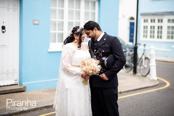 Couple photographed after wedding ceremony in Chelea Streets