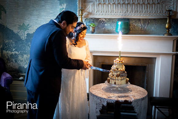 bride and groom cutting wedding cake at Hollywood Arms