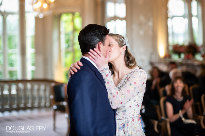 Wedding photograph of bride and groom kissing in London