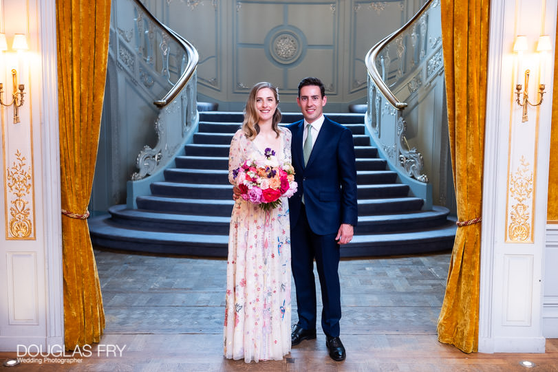 Formal photograph of bride and groom in London afer wedding
