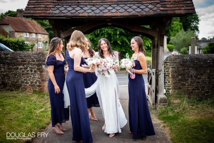 Surrey wedding photographer - bride arriving at church