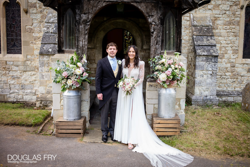 Surrey wedding photographer - couple in front of church