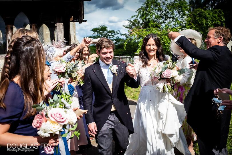 Confetti photograph of couple leaving the church