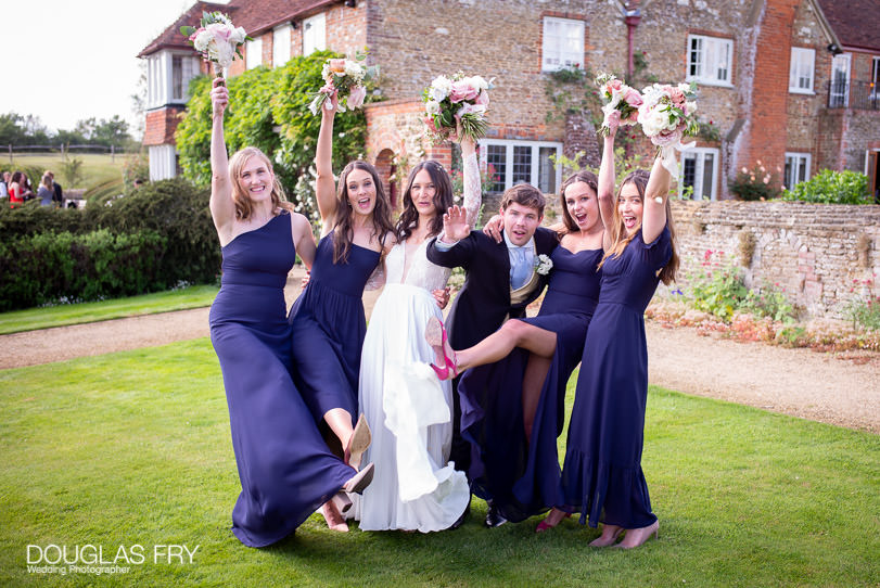country wedding photographer - bride with bridesmaids and bouquets