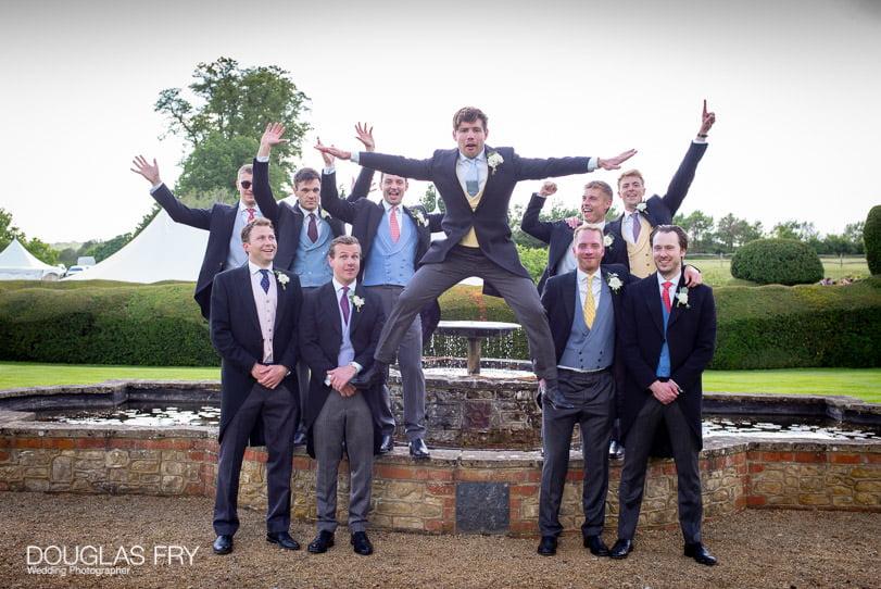 Groom photographed with best men in Surrey