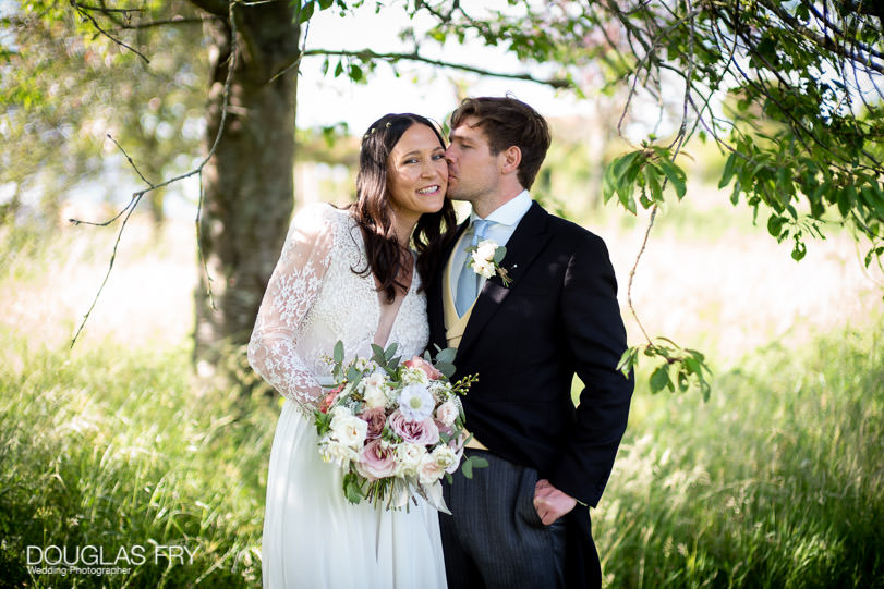 Wedding photographer - couple photograped in countryside