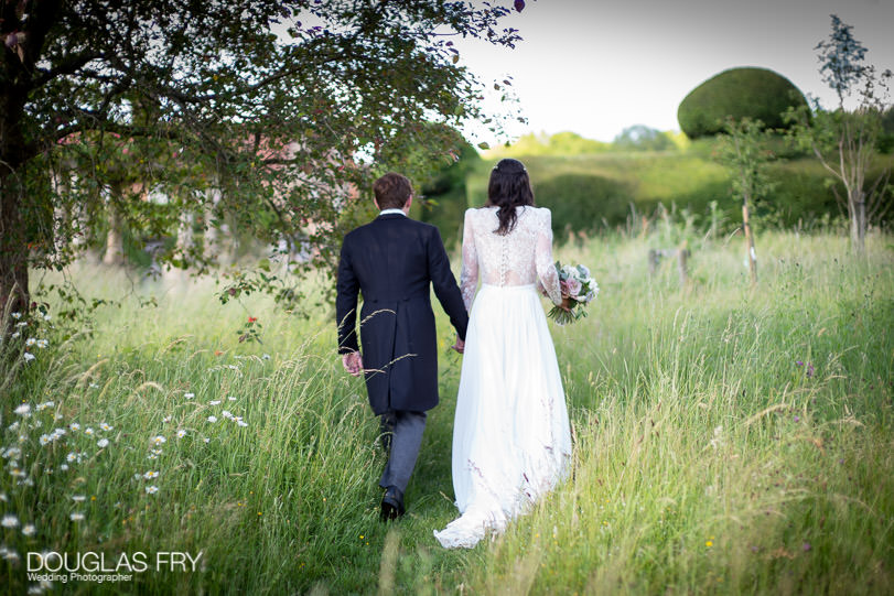 Romantic photograph of wedding - couple pictured in countryside