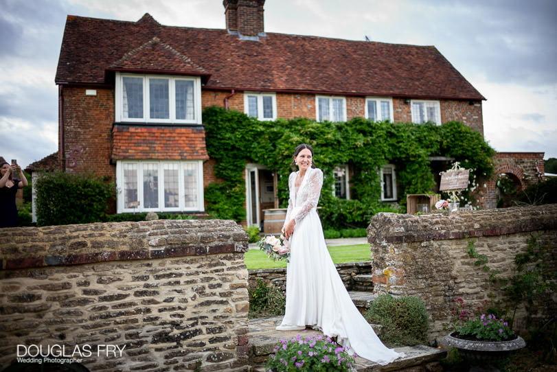 bride throwing bouquet at Surrey home