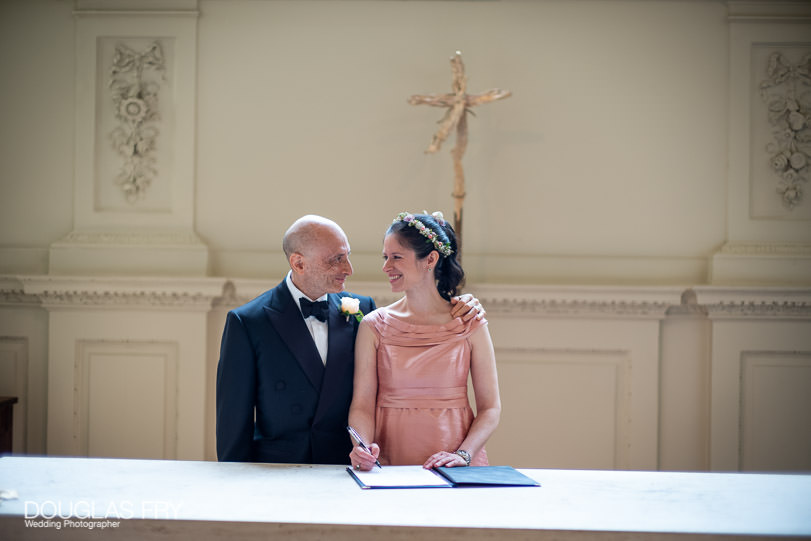 Signing the register at St Martin's in the Fields, London