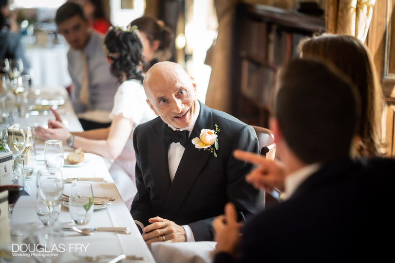Groom photographed during wedding reception at The Athenaeum Club